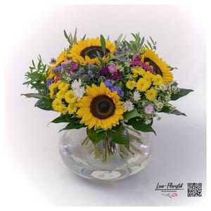 Sonnenblumen, Ageratum und Chrysanthemen